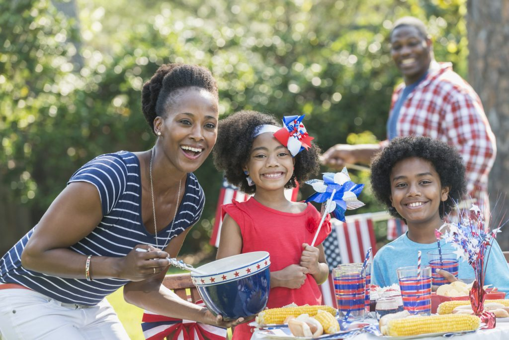 Family with two children celebrating Fourth of July